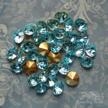 Vintage Czech rhinestones in aquamarine blue