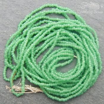 Size 20/0 seed beads - greasy palest green